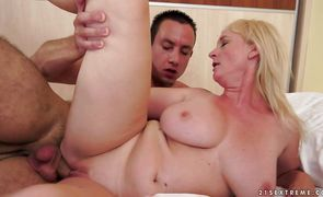 Striking mature blonde Monik with impressive tits takes a rod in her mouth and sucks it