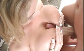 Naked blonde Amber Lynn Bach jumps on a hard chopper