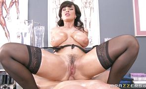 Delicious Lisa Ann sits down on a lever and she grinds