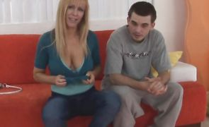 Tasty blonde cougar Nicole Moore with huge natural tits 's one fooling around in her bed